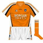 2007: After three years, Armagh and O'Neills decided on a change of kit, with white sleeves making a return of sorts, the neck now orange rather than white and black more to the fore than it had been.