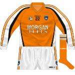 2008: Long-sleeved version of the 2007 jersey, with the inclusion of a number on the front. The new socks brought in in '07 were unusual in that the stripes were orange-black-orange, whereas those on the shirt and shorts were all orange with black outline.