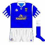 1995: A return to O'Neills resulted in the donning of what was a fairly ubiquitous design, incorporating 'half-striped' sleeves. Worn during the run to the Ulster final, where Cavan lost to Tyrone. Kingspan, still sponsoring the county, was the new name on the shirt.
