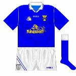 1996-98: A mix of old and new design elements, as O'Neills matched their altered collar design with the classic piping style. Shorts featured an interesting monochrome version of county crest.