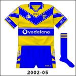 A few slight modifications were made to the Clare jersey for 2002, as white trim was added to the blue parts and the Vodafone name replaced that of Eircell following the multinational company's takeover of the mobile operator.