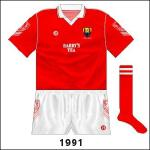 Two weeks after the Waterford game, Cork footballers played Kerry. With sponsorship allowed now, for this game and the Munster hurling final and replay loss to Tipperary the name of local company Barry's Tea featured on the jerseys.