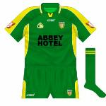 2003: Short sleeves, green collar with gold neck and sponsor included.
