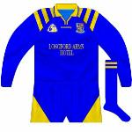 1998: Long-sleeved version of the 1995 shirt, now including the Longford Arms wordmark, used in the drawn match and replay win against Wexford in the Leinster championship.