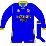 1999-2000: Longford returned to O'Neills for the 1999 season and the long-sleeved jersey for league games was just a standard design. Worn when the 2000 O'Byrne Cup was won, the blue shorts still in situ despite white having come in for the championship in '99.