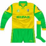 2000: Gold version of new jersey, in long-sleeved format, worn against Kerry in the league semi-final with green shorts.