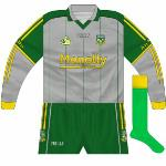 2006-07: With the launch of the new kit in 2006 was this new goalkeeper's outfit, a change from tradition. While it followed the design of the outfield top, it was grey with dark green sleeves and shorts.