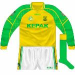 2004: Accompanying first incarnation of 2004 shirt, gold body with green sleeves. Interestingly, the county crest was rendered in a green outline.