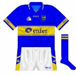 2002: The design evolved again with the new jersey. Initially, the collar had a gold and a white stripe...
