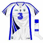 2012-13: After an absence of 10 years, white shorts returned to the Waterford kit. In addition, a unique neck insert also appeared, though the blue and navy flashes on the sleeves and lower body/upper shorts appeared superfluous.