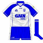 2005: For the 2005 All-Ireland hurling quarter-final with Cork, Waterford used a version of their jersey which featured a slightly different neck, with, unusually, the right part wrapping over the left.