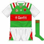 1995: A real oddity among the Mayo canon was the outfit used in 1995. Though the design was largely similar to before, the sleeves were now white with green and red stripes. Genfitt took over from Univet as sponsors.
