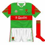 1996: A change in shorts design, with the county crest now featured alongside green and red stripes on the side.