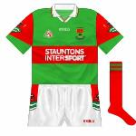1998: A new style with the county crest on the sleeve and the design replicated on the shorts. Sports shop firm Stauntons Intersport replaced Genfitt.